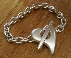do the chainmaille for the links and use the silver clay for a clasp? not loving the  heart but something more interesting?