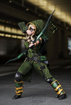 Female Green Arrow by Its-Raining-Neon cosplay costume LARP armor clothes clothing fashion player character npc | Create your own roleplaying game material w/ RPG Bard: www.rpgbard.com | Writing inspiration for Dungeons and Dragons DND D&D Pathfinder PFRPG Warhammer 40k Star Wars Shadowrun Call of Cthulhu Lord of the Rings LoTR + d20 fantasy science fiction scifi horror design | Not Trusty Sword art: click artwork for source