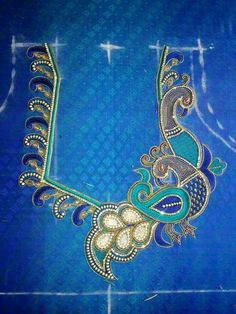Peacock hand work on blouse back neck.. get it http://mytailor.in/