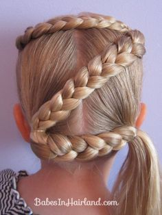 Did the Z & the T in Lyssa's hair today with blue white and red ribbons for spirit day...looks so cute! =)
