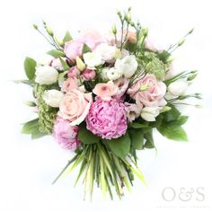Valentine's Day mixed pink and white bouquet. Gorgeous flowers in soft candy pinks and whites, with ranunculus, peonies, roses, tulips and lisianthus by London based Floral Designers Okishima & Simmonds. www.okishimasimmonds.com