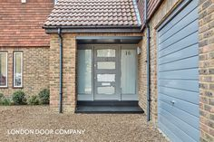 Modern grey front door with multiple glazed panels and full-length opaque sidelights. Finished with contemporary polished chrome door furniture. 1970s House, Contemporary Front Doors, House Exterior, Modern, Contemporary Decor, Front Door, Grey Front Doors, Contemporary House, Doors