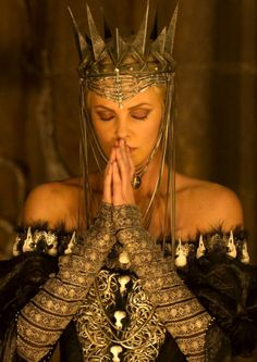 "Sorry, this movie got it wrong. Snow white was supposed to be BETTER looking than the evil queen. This evil queen is beautiful.  Charlize Theron as ""Queen Ravenna"" in Snow White and the Huntsman    Costume design by Colleen Atwood"