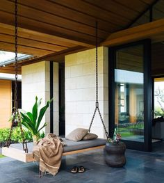 home boasts indoor/outdoor living that's complete with a relaxing bench swing to enjoy the Hawaiian breeze. Photo courtesy of Laure Joliet Outdoor Daybed, Indoor Outdoor Living, Outdoor Spaces, Outdoor Decor, Outdoor Furniture, Furniture Ideas, Modern Furniture, Outdoor Swings, Outdoor Photos