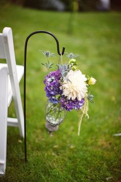 use this vintage jars to line aisle, the cylinder inside can be lifted out and moved inside after your ceremony.  Hang from ivory hook.