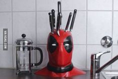 There's no question about how much we all loved Deadpool. So, why not add some Deadpool knife block to you kitchen? We guarantee this is probably the best knife block we've ever seen. Geek Decor, Dead Pool, Geek Culture, Knife Holder, Tv Holder, Batman The Dark Knight, Geek Gadgets, Knife Block, Kitchen Gadgets