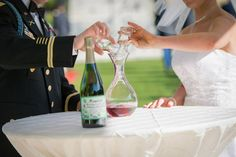 Wine themed wedding unity ceremony, white wine and red wine poured into carafe!