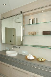 Bathroom Mirror Unit white bathroom with concealable vanity mirrors. phototim van