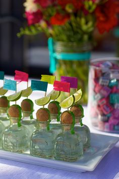 mini patron bottles with lime wedges and fiesta fringe picks