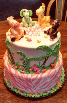 """""""Jungle Jill"""" Baby Shower cake! 2 tier, 8in and 10in round cake, all buttercream with candy clay accents! https://www.facebook.com/angelas.cakes2011"""