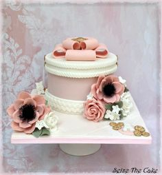 Hatbox cake with sugar anemones and roses