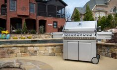 Napoleon Prestige PRO 665 (PRO665RSIB) with Infrared Rear and Side Burners. If I am on a wish list budget I could settle for this barbeque for $2,700. Stainless Steel finish, 8 Burners, 99,000 Total BTU's,  1,150.00 (Square Inches) Total Cooking Area, 42.00 - Burger Capacity (4 Inch Diameter), and what guy doesn't like Colored Lights i-GLOW™ / NIGHT LIGHT™ control knobs.