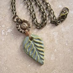 Artisan bronze and ceramic pendant leaf and by THEAjewellery