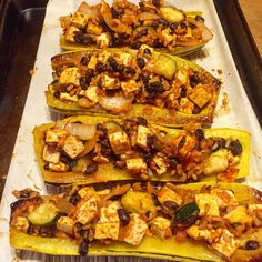 Ahhh...the flavors of Autumn Sweet & Savory! Roasted #Delicata #Squash stuffed with a spicy mixture of Brown Rice, Tofu, Black Beans, Onions, Zucchini, Tomatoes and Onions.  ----- #vegan #whatveganseat #veganfoodshare #vegansofig #bestofvegan #healthyliving #plantstrong #crueltyfreefood #meatfree #dairyfree #govegan #beetingtheodds #organicfood #nongmo