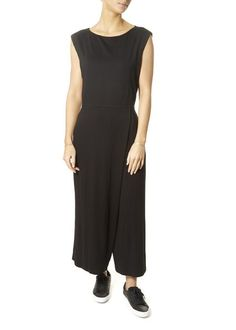 This is the Lightweight Jersey Black Jumpsuit by our friends at Eileen Fisher! A jumpsuit that thinks like a dress: fitted through the bodice with wide legs and a faux-wrap front. Easy, flared lines and the polish of our signature jersey. SHOP NOW! Womens Jumpsuits, Black Jumpsuit, Eileen Fisher, Wide Leg, Bodice, Dresses For Work, Skirts, Summer, London