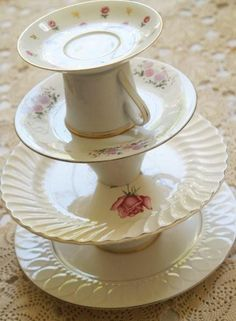 Anthro-Inspired Serving Tower.....I really like this idea BUT I think I would leave off the top cup and saucer and have only 3 layers and use a bigger plate on bottom and gradually decrease the size as I worked up.  That way it would be easy to take the food from the plates.  Really cute idea though.