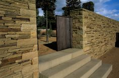 Contemporary gateway in dry stone using sandstone.