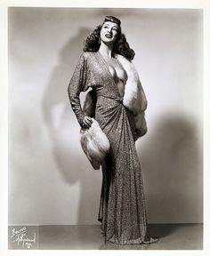 "Winnie Garrett   aka. ""The Flaming Redhead""..    A nice 40's-era promotional photo"