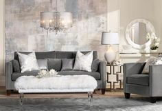 Living room with an acrylic bench and a sheer drum shade chandelier.