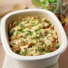 """Cheesy Chicken Chilaquiles - The Pampered Chef - """"This Mexican classic, a mixture of tortilla chips, cheese, vegetables and meat, gets an update as a layered microwave casserole."""" (The interesting word here is 'microwave' - making is a speedy dish.)"""