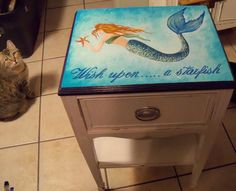 Mermaid starfish wish table, hand painted by me, Debbie Criswell, available to purchase at Treasure Trove in Hudson, Florida. Ocean, beach decor, painted furniture, tropical, mermaid, starfish, artist, art.
