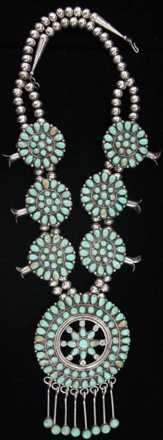 J. M. Begay (Navajo) sterling silver and turquoise squash blossom necklace.
