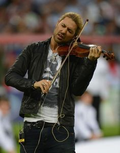 MUNICH, GERMANY - MAY 19: David Garrett perfoms during the opening ceremony ahead of the UEFA Champions League Final between FC Bayern Muenchen and Chelsea at the Fussball Arena München on May 19, 2012 in Munich, Germany.  (Photo by Lars Baron/Bongarts/Getty Images)