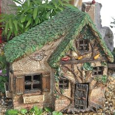Woodsy Way. www.teeliesfairygarden.com . . . Woodsy Way is an enchanted fairy house that suits any fairy garden. Most wouldn't even notice that it's a house because of its tree-like features. #fairyhouse