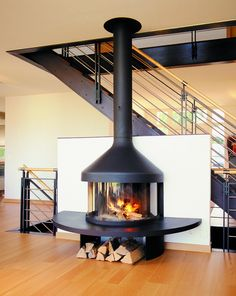 Free Standing Wood Burning Fireplace Living Room Contemporary with Fire Focus Hearth Logs Metal Railing Modern (basement living rooms wood stove) Stove Fireplace, Wood Fireplace, Living Room With Fireplace, Fireplace Design, Living Rooms, Fireplace Ideas, Wall Mounted Fireplace, Craftsman Fireplace, Custom Fireplace