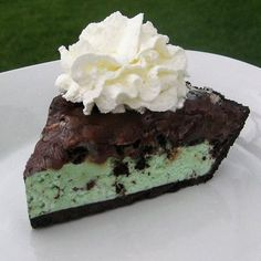 Mint Chocolate Ice Cream Pie with Oreo Crust topped with Chocolate Sauce and Whipped Cream