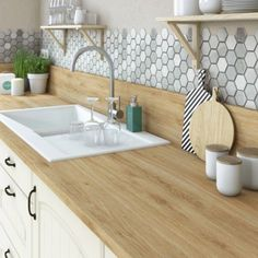 Loving the hexagonal penny tile and the way the wooden benchtop blends seemlessly into the splashback...