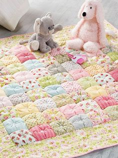 "This is a great project for a floor quilt for a little one if the buttons are not used, or use it as a lap quilt to keep handy if a chill arises. Finished size is 48"" x 48""."