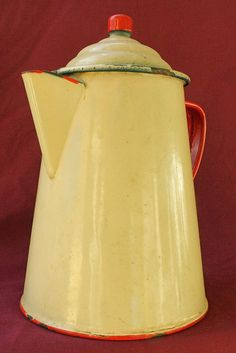 "Antique Graniteware Coffee Pot with Enamel Finish    This old graniteware coffee pot has a cream colored enamel finish with red trim. It measures 9 1/2"" tall and is 6 1/2"" in diameter.  Tin Can Alley    inside the Castle Rock Mercantile Antique Mall  160 H Huntington Avenue N  Castle Rock, WA 98611 www.bagtheweb.com/b/UG8KRi bagtheweb.com/b/E7Kxc0  Vintage Northwest: bagtheweb.com/vintage"