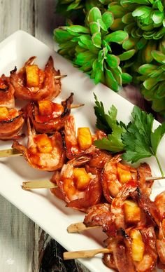Paleo, Gluten-Free - Shrimp, Pineapple and Bacon Skewers. This was a fun recipe I found to mimic Hawaiian pizza. Paleo keeps dough and cheese out of the diet, but this looked like something that would give me the yummy, sweet pineapple and crunchy, flavored bacon all wrapped together with my favorite seafood, shrimp!