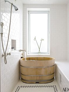 A Japanese hinoki-wood soaking tub anchors Midler's bath.