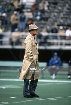 Head coach Tom Landry of the Dallas Cowboys looks on while his team stretches during pre-game warm ups before an NFL football game circa 1977 at Texas Stadium in Dallas, Texas. Landry coached the Cowboys from 1960-88.