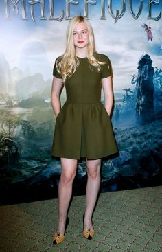 At the Paris photo call for Maleficent, Elle Fanning looked youthfully chic in a mossy green fit-and-flare dress from the Valentino pre-fall 2014 collection and Charlotte Olympia Sleeping Beauty pumps (because, duh).
