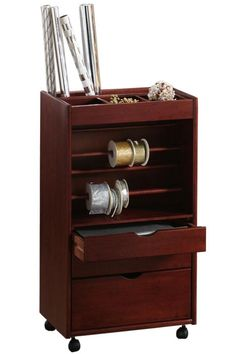 The Stanton Wrapping Cart is specially designed to hold your paper, ribbon, scissors, tape and more. Order yours today and wrap up your holiday to-dos in no time! Includes eight ribbon dowels (four small, four large). Casters offer convenient mobility, so the cart can be moved easily to where you need it most. Expertly crafted from wood for years of lasting beauty and use. $180