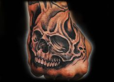 skull tattoo designs for the back of hand | skull tattoo on hand