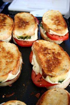 Italian bread, mozzeralla cheese, tomato, pesto, drizzle olive oil...grill. loooove.
