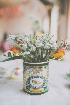 Tin Flowers Centrepiece Crafty Colourful Village Hall Wedding http://jamesmelia.com/