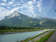 The Rhine: Border between Liechtenstein and Switzerland (view to the Swiss Alps)