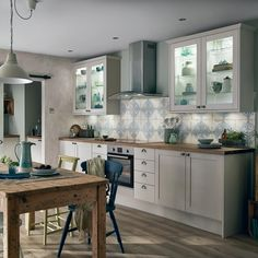Inspired by Shaker design, this cabinet door is thick with a wood grain detail which replicates the look of solid timber. Cabinet options include half-height and extra tall wall units to maximise storage. Kitchen Taps, Kitchen Units, Kitchen Doors, Kitchen Storage, Cosy Kitchen, Kitchen Small, Kitchen Cupboards, Kitchen Organization, Kitchen Dining