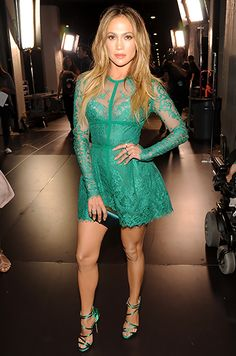 Jennifer Lopez wore an emerald lace fit-and-flare dress with matching strappy sandals to present at the 2014 Teen Choice Awards.