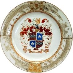 Large Chinese Export Armorial Charger from Lee of Coton Service, circa 1735. Considered the finest armorial service ever ordered by an English family. The border with early scenes of both London and the port of Canton.