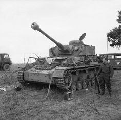 Captured late Pz.Kpfw. IV Ausf. G (7,5 cm Kw.K L/48) at 27th Armoured Brigade workshops, Normandy, 3 July 1944.