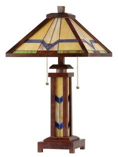 ALEXANDER, a Mission style lighted base wooden table lamp will provide the design focal point for your home. Expand the effect by adding one or more of the other lamps in this design style. Expertly handcrafted with top quality materials including real stained glass and rubber wood frame in dark walnut finish. The lighted base can be used alone whenever low light levels are desired.*FREE Shipping* - Please allow 7 - 10 business days for shipping. Every piece of lighting artwork is hand…