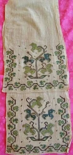 A women's 'uçkur' (sash / waist band), made of wild silk, with embroidered ends. Northwestern Anatolia, urban style, ca. 1900. With a stylized 'tree of life'-motif, surrounded by branches of the vine.*****