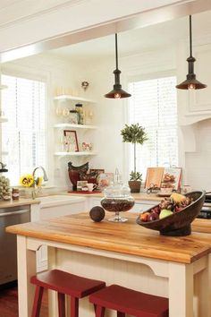 The kitchen opens onto the living area so the chef can join in the fun. Open shelving, plentiful dra... - Photos by Jean Allsopp