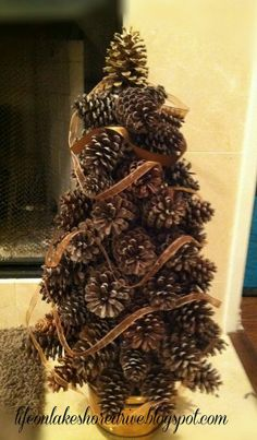you will not believe how easy this is.and no styrofoam! Life on Lakeshore Drive: Pine Cone Tree TutorialWow! you will not believe how easy this is.and no styrofoam! Life on Lakeshore Drive: Pine Cone Tree Tutorial Pine Cone Tree, Cone Trees, Pine Cones, Noel Christmas, Country Christmas, Winter Christmas, Christmas Ornaments, Primitive Christmas, Pine Cone Christmas Tree